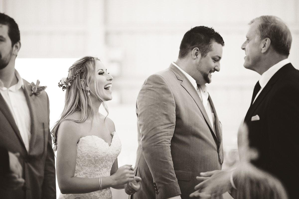 bride groom laughing