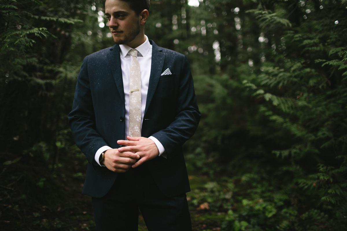 sunshine coast elopement-groom in the woods
