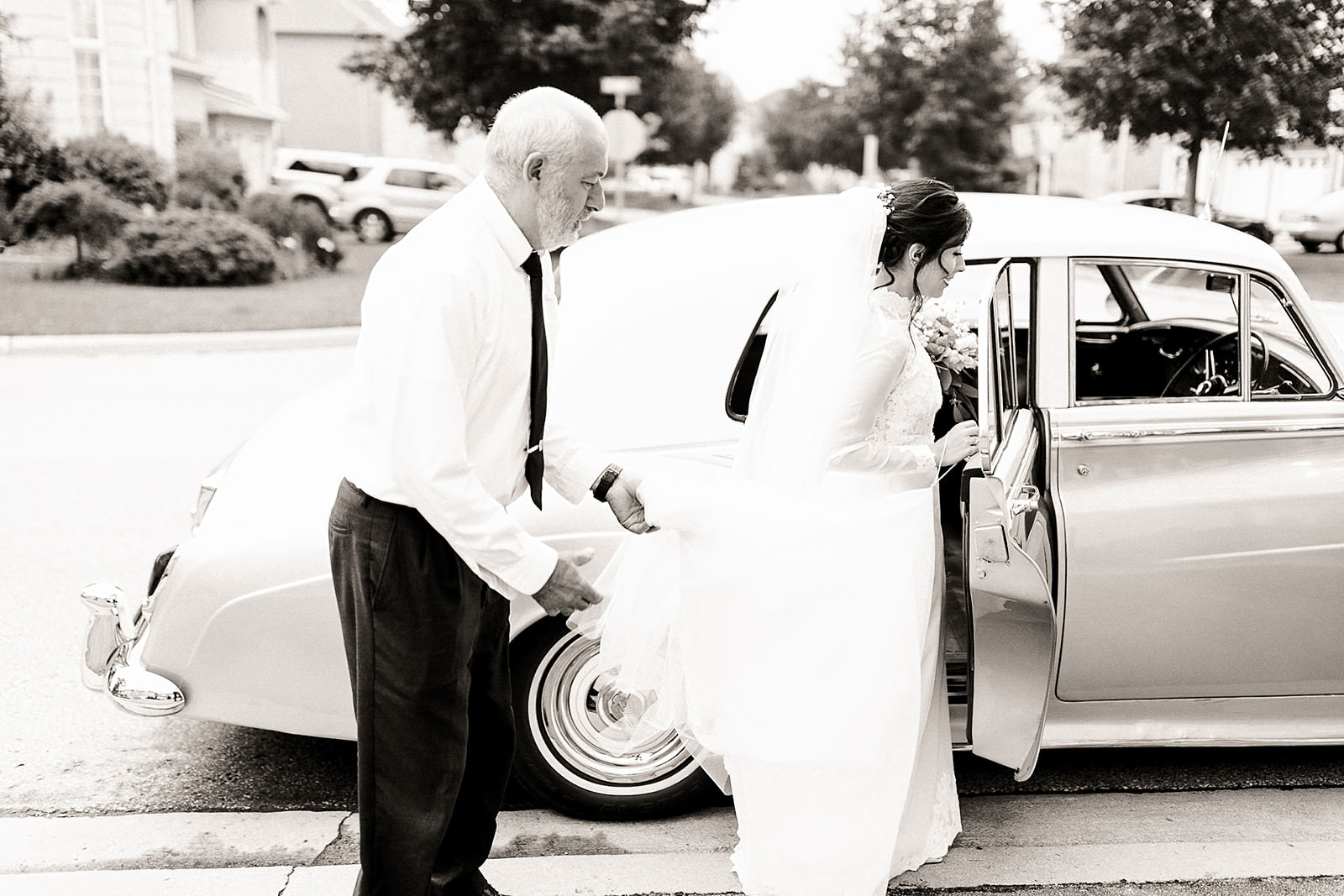 Bride getting into classic car wedding toronto